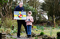 Pictured: Elly Neville with her father Lyn with the flag she created and The British Citizen Award for the Good of the Country at her home in Pembroke, west Wales, UK. Tuesday 20 February 2018<br /> Re: Seven-year-old Elly Neville who was born despite doctors saying her parents would not be able to have any more children, has raised over £150,000 for the cancer ward that treated her father.<br /> Her parents Lyn and Ann had been told they were unlikely to have more children after he underwent a bone marrow transplant in 2005. <br /> Mr Neville subsequently spent a lot of time on the Ward 10 cancer facility at Withybush Hospital in Haverfordwest, Pembrokeshire.<br /> But four years later they were stunned when his painter and decorator wife Ann fell pregnant again.