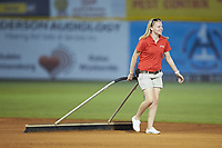 Pulaski Yankees Assistant General Manager Betsy Haugh helps drag the infield between innings of the game against the Princeton Rays at Calfee Park on July 14, 2018 in Pulaski, Virginia. The Rays defeated the Yankees 13-1.  (Brian Westerholt/Four Seam Images)