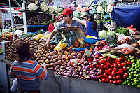 Fruits and vegetables for sale at an open air market.