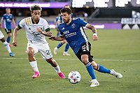 SAN JOSE, CA - MAY 15: Pablo Bonilla #28 of the Portland Timbers chases Eric Remedi #5 of the San Jose Earthquakes during a game between San Jose Earthquakes and Portland Timbers at PayPal Park on May 15, 2021 in San Jose, California.