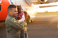 SANTO DOMINGO, Dominican Republic - Capt. Luis Martinez, of Puerto Rico Air National Guard, U.S. Southern Command, carries a young girl, evacuated by crewmembers aboard an HC-130 Hercules aircraft from Clearwater, Fla., Jan. 14, 2010.  Coast Guard crews from Clearwater, Fla., are working in conjunction with multiple branches of the U.S. military, U.S. Governmnent, military services from around the world, and the United Nations, on a second straight day of evacuations from Port-au-Prince, Haiti. U.S. Coast Guard Photo by Petty Officer 1st Class Mariana O'Leary