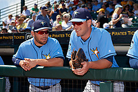 Tampa Bay Rays Curt Casali (left) and Casey Gillaspie (right) in the dugout before during a Spring Training game against the Pittsburgh Pirates on March 10, 2017 at LECOM Park in Bradenton, Florida.  Pittsburgh defeated New York 4-1.  (Mike Janes/Four Seam Images)