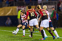 Kelley O'Hara (5) of the United States (USA) passes the ball. The United States (USA) and Germany (GER) played to a 2-2 tie during an international friendly at Rentschler Field in East Hartford, CT, on October 23, 2012.