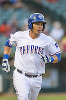 Round Rock Express first baseman Carlos Pena (33) runs to first base during the Pacific Coast League baseball game against the Fresno Grizzlies on June 22, 2014 at the Dell Diamond in Round Rock, Texas. The Express defeated the Grizzlies 2-1. (Andrew Woolley/Four Seam Images)