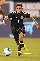 EAST RUTHERFORD, NJ - SEPTEMBER 7: Carlos Rodriguez #8 of Mexico kicks the ball during a game between Mexico and USMNT at MetLife Stadium on September 6, 2019 in East Rutherford, New Jersey.