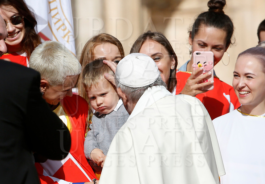 Pope Francis greets a child at the end of his weekly general audience in St. Peter's Square at the Vatican City, October 16, 2019.<br /> UPDATE IMAGES PRESS/Riccardo De Luca<br /> <br /> STRICTLY ONLY FOR EDITORIAL USE