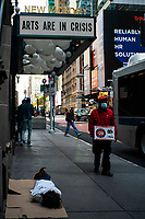 NEW YORK, NY - OCTOBER 20: A homeless rests in front of a local theater in Times Square on October 20, 2020 in New York, with more than a 72% decline in tourism activity since the spread of the pandemic. Hotels, restaurants, museums, are more affected across New York State.  (Photo by Eduardo MunozAlvarez/VIEWpress)