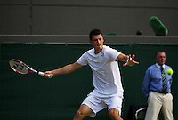 01-07-13, England, London,  AELTC, Wimbledon, Tennis, Wimbledon 2013, Day seven, Bernard Tomic (AUS)<br /> <br /> <br /> <br /> Photo: Henk Koster