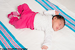 10 day old newborn baby girl on back full length drowsy reflex tonic neck fencing