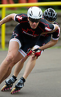 11 AUG 2013 - BIRMINGHAM, GBR - Sutton Atkins of East Midlands Racing takes a bend during his Senior Men's 1000m heat at the Federation of Inline Speed Skating 2013 British Outdoor Championships at Birmingham Wheels Park in Birmingham, West Midlands, Great Britain (PHOTO COPYRIGHT © 2013 NIGEL FARROW, ALL RIGHTS RESERVED)