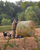 Shooting stations at the dove field      Sept. 4 2021    are marked with round bales of hay. <br />(NWA Democrat-Gazette/Flip Putthoff)