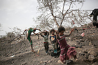 Thursday 09 July, 2015: Displaced children from the heavy fighting and bombardments in Haradh bordertown are seen in Darawan, a temporary settlement in the outskirts of Sana'a, the capital city of Yemen. (Photo/Narciso Contreras)