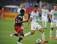 WASHINGTON, DC - JULY 7: Ian Smith #12 of Liga Deportiva Alajuense battles for the ball with Gaoussou Samake #45 of D.C. United during a game between Liga Deportiva Alajuense  and D.C. United at Audi Field on July 7, 2021 in Washington, DC.