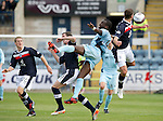 Dundee v St Johnstone....29.09.12      SPL.Gregory Tade gets between Mark Kerr and John Baird.Picture by Graeme Hart..Copyright Perthshire Picture Agency.Tel: 01738 623350  Mobile: 07990 594431