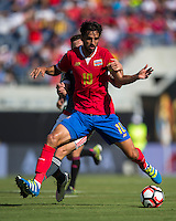 Orlando, Florida - Saturday, June 04, 2016: Costa Rican midfielder Bryan Ruiz (10) protects the ball from Paraguayan forward Robert Piris Da Motta (23) during a Group A Copa America Centenario match between Costa Rica and Paraguay at Camping World Stadium.