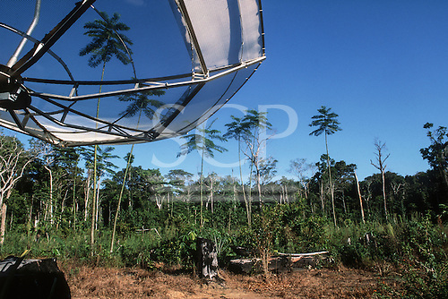 Juruena, Mato Grosso State, Brazil. Satellite dish for television in a remote settler farm in recently deforested area.