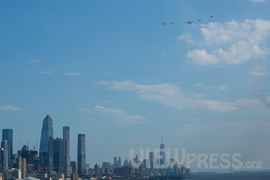 WEST NEW YORK, NJ - JULY 26: Fighter jets are seen during a flyover over de Hudson River during Independence Day on July 4, 2020 from West New York, New Jersey .(Photo by Kena Betancur/ VIEWpress via Getty Images)