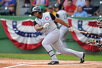Yasiel Balaguert #22 of the Kane County Cougars swings against the Clinton LumberKings at Ashford University Field on July 6, 2014 in Clinton, Iowa. The LumberKings won 1-0.   (Dennis Hubbard/Four Seam Images)