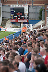 Hartlepool United 0 Middlesbrough 0, 20/07/2013. Victoria Ground, Pre-Season Friendly. Supporters of Middlesbrough watching the closing moments at the Victoria Ground, Hartlepool, during a pre-season friendly between their team and Hartlepool United. Hartlepool were relegated to League Two at the end of the 2012-13 season whilst their Teesside neighbours remained two divisions above them in the Championship. The game ended in a no-score draw watched by a crowd of 2307. Photo by Colin McPherson.