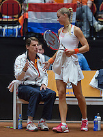 The Netherlands, Den Bosch, 16.04.2014. Fed Cup Netherlands-Japan,Dutch bench with captain Paul Haarhuis  and Arantxa Rus<br /> Photo:Tennisimages/Henk Koster