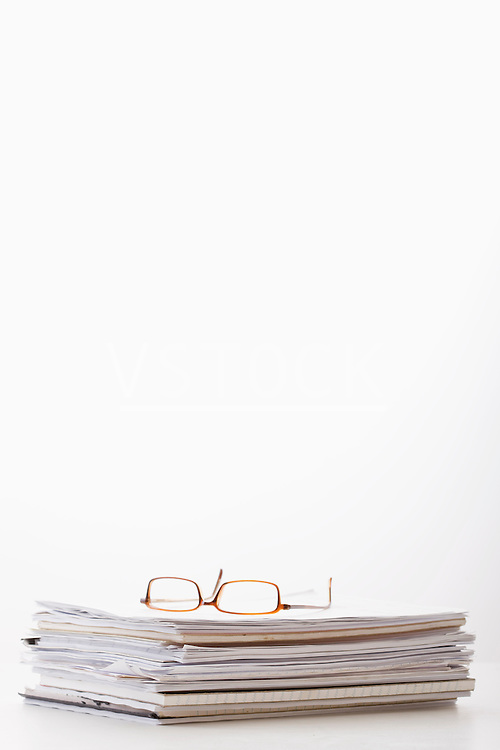 Spectacles on stack of documents