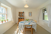 """BNPS.co.uk (01202) 558833. <br /> Pic: KnightFrank/BNPS<br /> <br /> Pictured: Holiday let dining room. <br /> <br /> A castle that was burnt down by a pirate, involved in the English Civil War and has been in the same family for five centuries is on the market for offers over £650,000.<br /> <br /> Kilberry Castle, which dates back to the 15th century, has an incredible history and still has a wealth of original features including a 288-year-old mausoleum.<br /> <br /> It sits in 21 acres of land on the Scottish west coast, with stunning views over Kilberry Bay and out to the islands of Islay, Jura and Gigha.<br /> <br /> The four-storey tower house now needs a buyer """"with deep pockets and great imagination"""" to carry out a complete refurbishment but it has a lot of potential."""