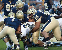 Pittsburgh defensive lineman Myles Caragein (94) along with other Pitt defensive player wrap up  Navy fullback Alexander Teich (39). The Pittsburgh Panthers defeated the Navy Midshipmen 27-14 at Heinz Field, Pittsburgh, PA.