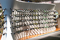 One of the exhibition booths displaying rows of wine bottles in curved shapes. At the Vinordic wine trade show. Stockholm. Sweden, Europe.