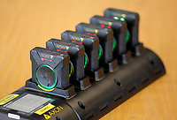 "The AXON bodycams on their charge and download cradle. Wednesday 17 May 2017<br /> Re: Body worn video cameras are being introduced into the South Wales Police force as part of operational equipment and will be rolled out over the next few months.<br />  Forces across the UK are using this technology and integrating it into daily policing activities.  Body worn video may be used in court as evidence and for investigative purposes, including complaints against police or as a training material for police. <br />  Other forces have seen a range of benefits from using body worn video to support their general patrolling and investigative tasks. These benefits include:<br /> Gathering and presentation of evidence<br /> Changing the behaviour of offenders<br /> Lower incidence or escalation of violence<br /> Increased guilty pleas by defendants<br /> Increased time on patrol and less time spent on paperwork<br /> Improved public co-operation and interactions with police<br /> Improved transparency and accountability<br /> Professionalising police interaction<br /> Assistant Chief Constable Richard Lewis said: ""Equipping our officers with body worn cameras is the start of a new way we capture, utilise and share digital evidence.  The technology is very exciting and will assist officers and staff in doing their jobs, it will ensure that we are more accountable to the public that we serve and in turn build trust with our communities."
