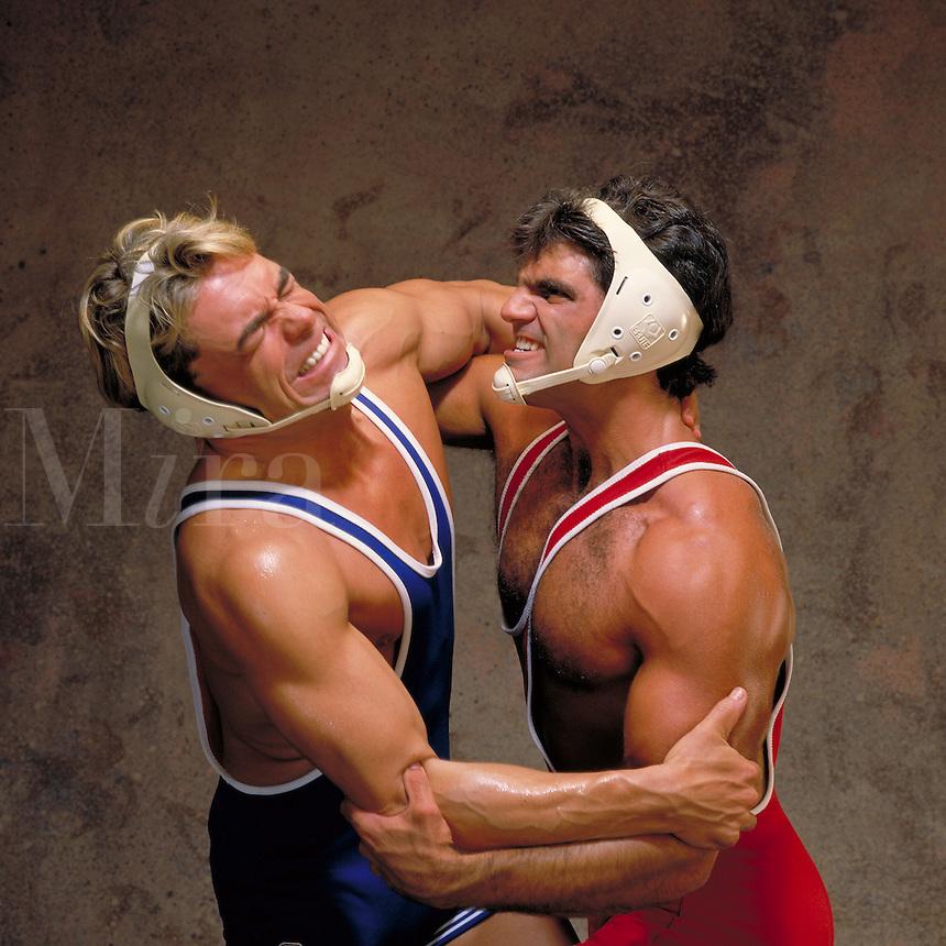 Collegiate wrestlers, wrestling, using protective headgear. Little Rock, Arkansas.
