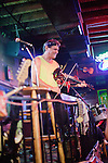 The Danny T Band (Danny T on fiddle) plays a mean zydeco at a bar on New Orleans, Louisiana's famed Bourbon Street.
