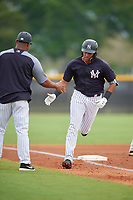 New York Yankees Wilkerman Garcia (3) rounds the bases after hitting a home run during a Minor League Spring Training game against the Atlanta Braves on March 12, 2019 at New York Yankees Minor League Complex in Tampa, Florida.  (Mike Janes/Four Seam Images)