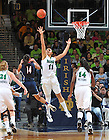 Jan. 7, 2012; Connecticut Huskies guard Bria Hartley (14) shoots as Notre Dame Fighting Irish forward Natalie Achonwa (11) defends in the second half at the Purcell Pavilion. Notre Dame won 74-67 in overtime. <br /> <br /> Photo by Matt Cashore