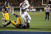 BERKELEY, CA - September 17, 2016: Cal's (7) Khari Vanderbilt attempts to stop Texas running back (25) Chris Warren from scoring a touchdown at Cal Memorial Stadium.