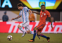Action photo during the match Argentina vs Chile, Corresponding to Great Final of the America Centenary Cup 2016 at Metlife Stadium, East Rutherford, New Jersey.<br /> <br /> <br /> Foto de accion durante el partido Argentina vs Chile, correspondiente a la Gran Final de la Copa America Centenario 2016 en el  Metlife Stadium, East Rutherford, Nueva Jersey, en la foto: (i-d) Lionel Messi de Argentina y Arturo Vidal  de Chile<br /> <br /> <br /> 26/06/2016/MEXSPORT/David Leah.