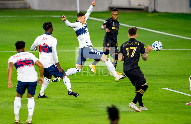 LOS ANGELES, CA - SEPTEMBER 23: Diego Palacios #12 of LAFC crosses a ball during a game between Vancouver Whitecaps and Los Angeles FC at Banc of California Stadium on September 23, 2020 in Los Angeles, California.