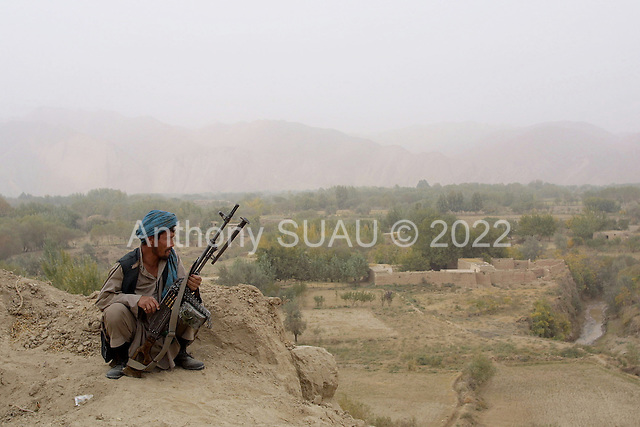 Khogebha Hoddin, Northern Afghanistan <br /> October 2001<br /> <br /> At the Norhtern Allience front near Khogebha Hoddin troups stand guard over a post looking down on the Taliban positions.<br /> <br /> They were expecting American strikes on the Taliban positions later that night.
