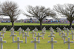 Riders pass by French World War I memorial graves during the 113th edition of the Paris-Roubaix 2015 cycle race held over the cobbled roads of Northern France. 12th April 2015.<br /> Photo: Eoin Clarke www.newsfile.ie