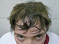 Young boy hockey player after game with dirty, sweaty hair. From Verizon Droid camera.