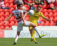 Fleetwood Town's Josh Morris squeezes a shot past Doncaster Rovers' Reece James<br /> <br /> Photographer David Shipman/CameraSport<br /> <br /> The EFL Sky Bet League One - Doncaster Rovers v Fleetwood Town - Saturday 17th August 2019  - Keepmoat Stadium - Doncaster<br /> <br /> World Copyright © 2019 CameraSport. All rights reserved. 43 Linden Ave. Countesthorpe. Leicester. England. LE8 5PG - Tel: +44 (0) 116 277 4147 - admin@camerasport.com - www.camerasport.com