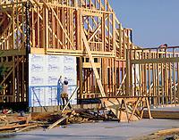 New home construction in suburban development. Installing insulating sheathing on framed house. Houston Texas.