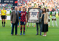 AUSTIN, TX - JUNE 16: Carli Lloyd #10 of the USWNT poses with Will Wilson and Kate Markgraf before a celebration of her 300th cap during a game between Nigeria and USWNT at Q2 Stadium on June 16, 2021 in Austin, Texas.