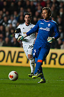 Thursday 28 November  2013  Pictured: Alvaro Vasquez tries to challenge Diego Alves of Valencia<br /> Re:UEFA Europa League, Swansea City FC vs Valencia CF  at the Liberty Staduim Swansea