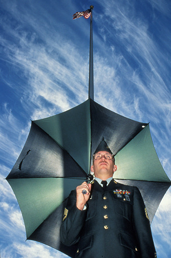 Sgt. 1st Class Robert M. Diehl and other soldiers at Camp Parks, California are not allowed to use an umbrella while in uniform. This policy is found in the U.S. Army and U.S. Marine Corps. (photo by Pico van Houtryve)