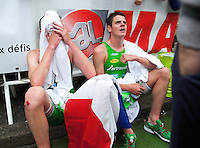 17 SEP 2011 - LA BAULE, FRA - EC Sartrouville's Alistair Brownlee (left) and his brother and team mate Jonathan Brownlee recover after finishing the final round of the men's French Grand Prix Series at the Triathlon Audencia in La Baule, France (PHOTO (C) NIGEL FARROW)