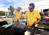 OKTOBERFEST AROMA<br />Robert Porter (left) and Russell Marino, both with the Rogers Downtown Rotary Club, grill brats on Saturday Oct. 9 2021 at the downtown Rogers Oktoberfest at Railyard Park. Several craft breweries served cold beer and Bavarian music and costume contests took place on the Butterfield Stage. Go to nwaonline.com/211010Daily/ to see more photos.<br />(NWA Democrat-Gazette/Flip Putthoff)