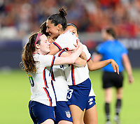 HOUSTON, TX - JUNE 10: Samantha Mewis #3 of the United States celebrates her goal in the second half with Rose Lavelle #16 and Christen Press #23 during a game between Portugal and USWNT at BBVA Stadium on June 10, 2021 in Houston, Texas.