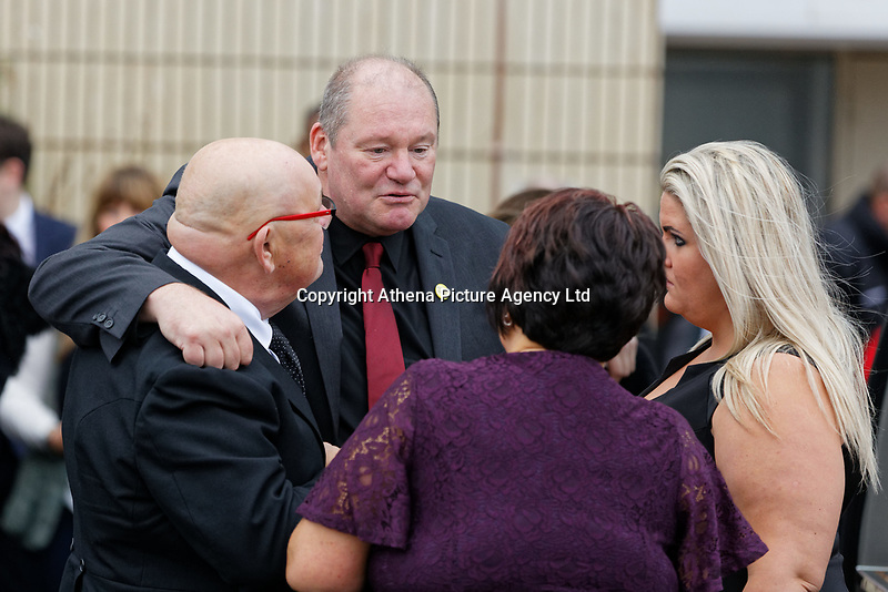 """Pictured: Byron John (C) the father of Bradley greets mourners at Aberavon Beach Hotel in Port Talbot, Wales, UK. Monday 08 October 218<br /> Re: A grieving father will mourners on horseback at the funeral of his """"wonderful"""" son who killed himself after being bullied at school.<br /> Talented young horse rider Bradley John, 14, was found hanged in the school toilets by his younger sister Danielle.<br /> Their father, farmer Byron John, 53, asked the local riding community to wear their smart hunting gear at Bradley's funeral.<br /> Police are investigating Bradley's death at the 500-pupils St John Lloyd Roman Catholic school in Llanelli, South Wales.<br /> Bradley's family claim he had been bullied for two years after being diagnosed with Attention Deficit Hyperactivity Disorder.<br /> He went missing during lessons and was found in the toilet cubicle by his sister Danielle, 12."""