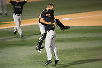 Wake Forest Demon Deacons catcher Logan Harvey (15) jumps into the arms of relief pitcher Griffin Roberts (43) after the final out of their win over the West Virginia Mountaineers in Game Six of the Winston-Salem Regional in the 2017 College World Series at David F. Couch Ballpark on June 4, 2017 in Winston-Salem, North Carolina.  The Demon Deacons defeated the Mountaineers 12-8.  (Brian Westerholt/Four Seam Images)