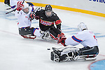 Sochi, RUSSIA - Mar 9 2014 -  Anthony Gale goes for the puck during Canada vs. Norway at the 2014 Paralympic Winter Games in Sochi, Russia.  (Photo: Matthew Murnaghan/Canadian Paralympic Committee)